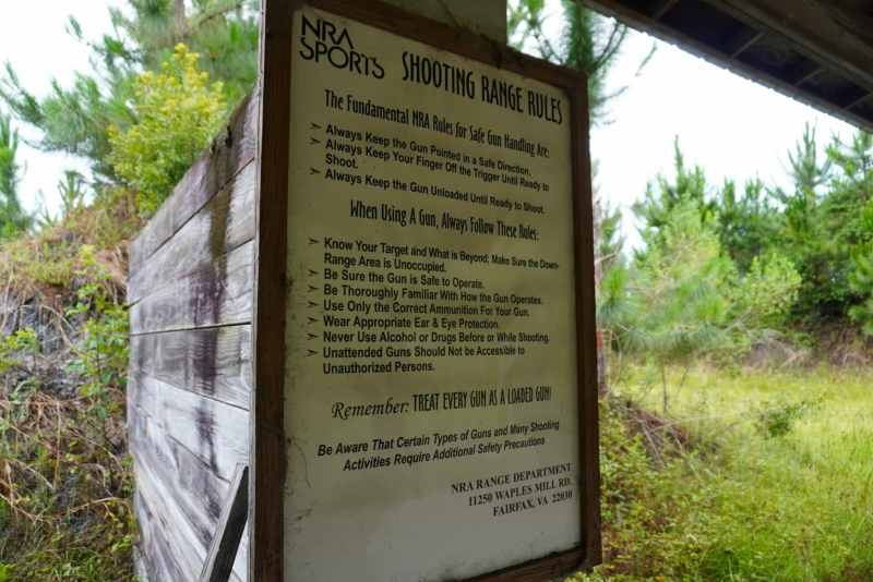 A sign details the rules at an outdoor shooting range