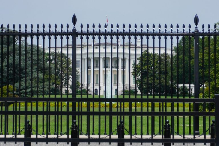 The White House set behind its security fence