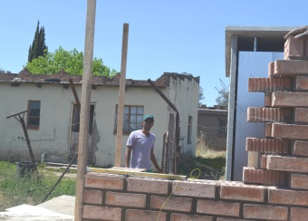 HEALTH HAZARD: Thobelani Lena is not happy with the new pit toilets which are being built behind his house for the shack dwellers in the R section in Mlungisi Picture: BHONGO JACOB