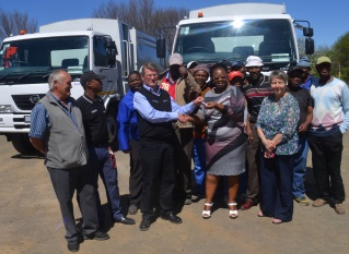 NEW WHEELS: Enoch Mgijima Municipality executive mayor Lindiwe Gunuza Nkwentsha received keys to two new compactor trucks last Thursday from UD Trucks sales manager John McKenzie Picture: ZOLILE MENZELWA