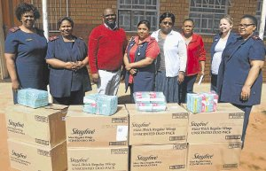 September 2016: FOR THE CHILDREN: Life Health Care Private Hospital donated sanitary towels to Edlelweni Primary School. From left are Nosipho Siko, Desiree Pedro, principal Zukisani Sondlo, Jessica Nadesen, Thembakazi Ncedani, Nobuntu Booi, Mellisa Stone and Life Care community involvement project chairman Wendy Giyose Picture: ABONGILE SOLUNDWANA © The Rep
