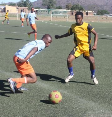 THE FAST AND THE FURIOUS: Komani Stars ' Wanda Sani, left, in action with Milan FC's Sizwe Mzayifani during the Top Notch Soccer tournament at the Dumpy Adams sports field on Saturday Picture: BHONGO JACOB