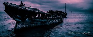 Shipwreck off Heron Island, Queensland in a moody scene with storm coming.