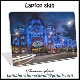 Laptop skin clock showing the Flinders Street Station from Melbourne, Victoria in Australia. The building is lit with blue.