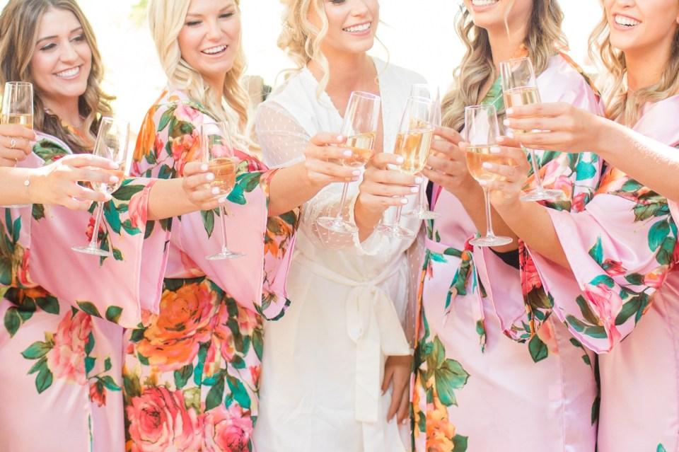 Bridesmaids toast on wedding day