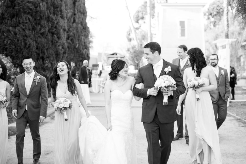 Bride and groom walking with their wedding party at Heritage Museum Orange County