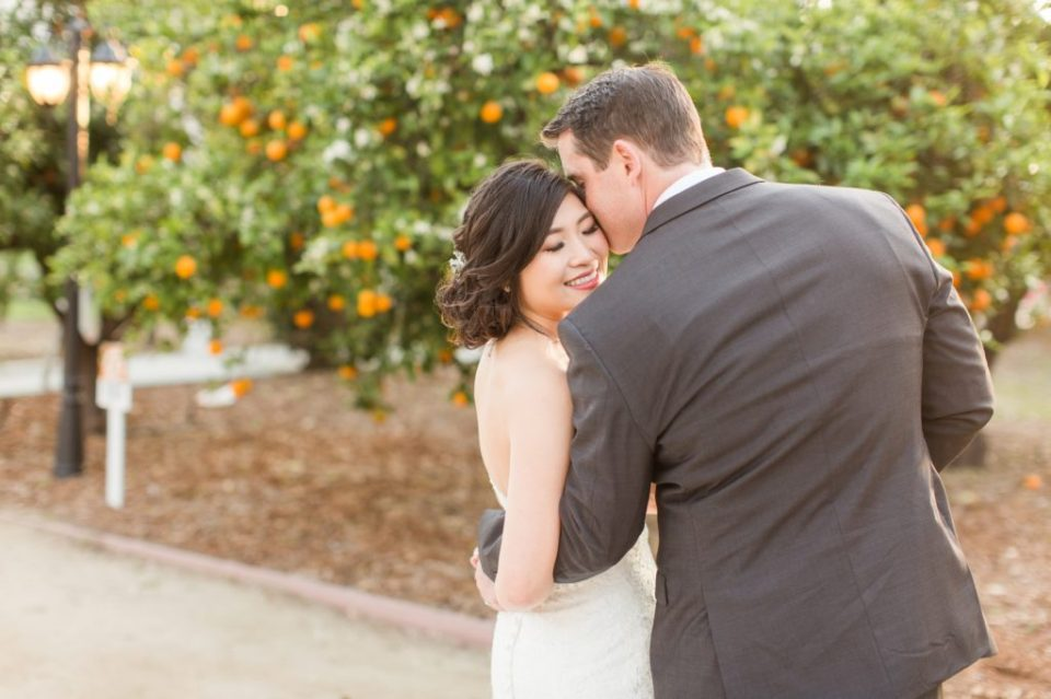 Couple kissing in an Orange Grove at Orange County Wedding Venue, Heritage Museum.