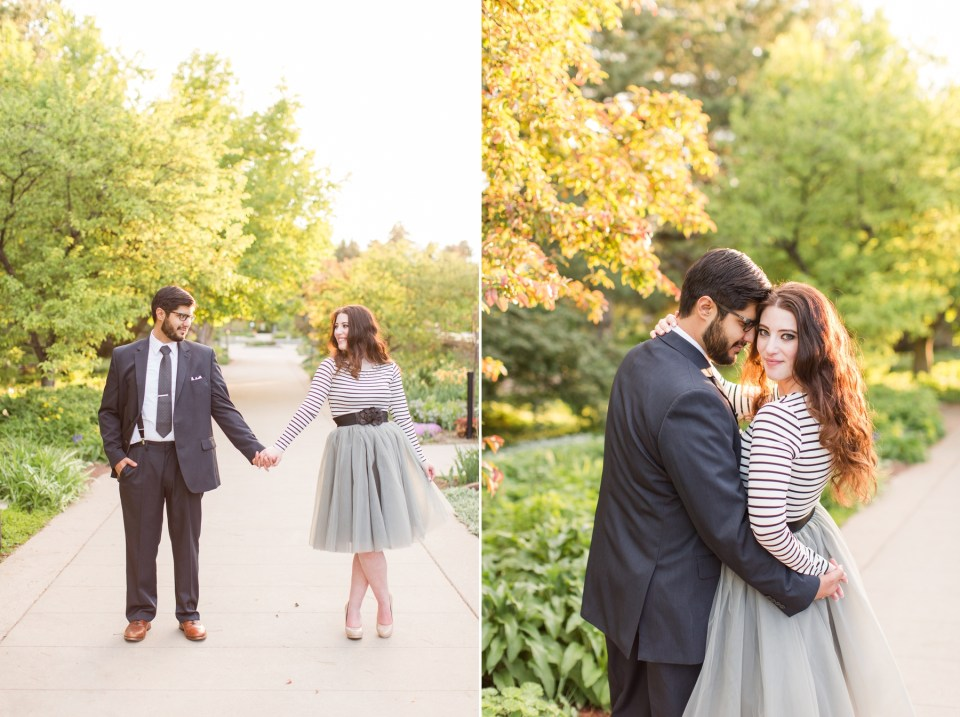 Bride and groom at the Denver Botanical Gardens in Spring for an engagement session. Bride in a grey tule skirt with stripped long sleave top and groom in a three piece suit.