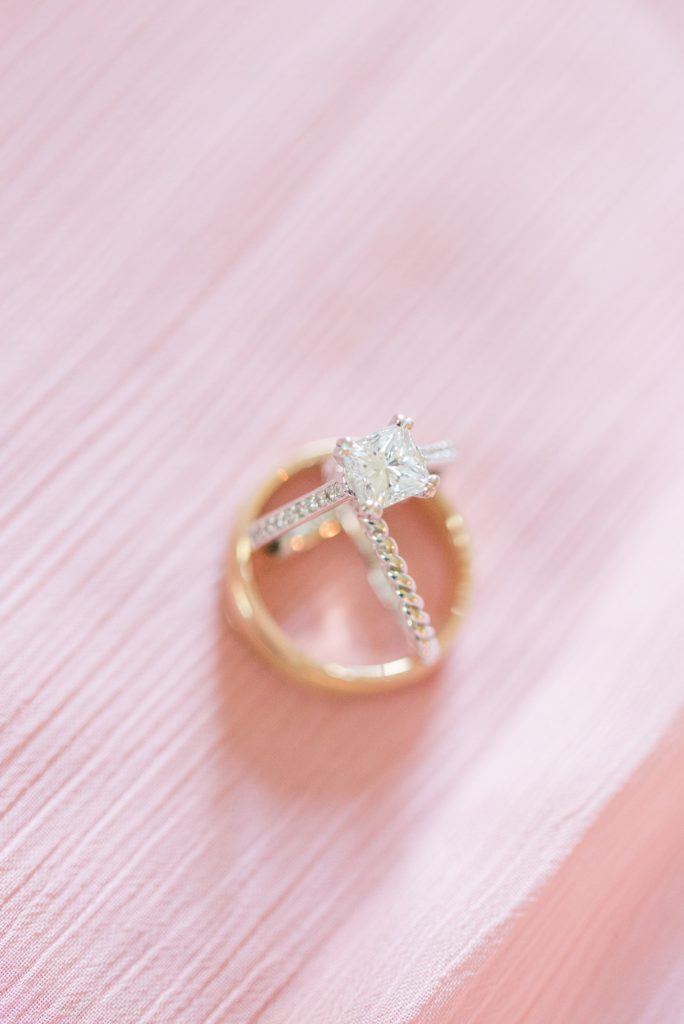 Diamond Solitair engagement ring on a pink background.