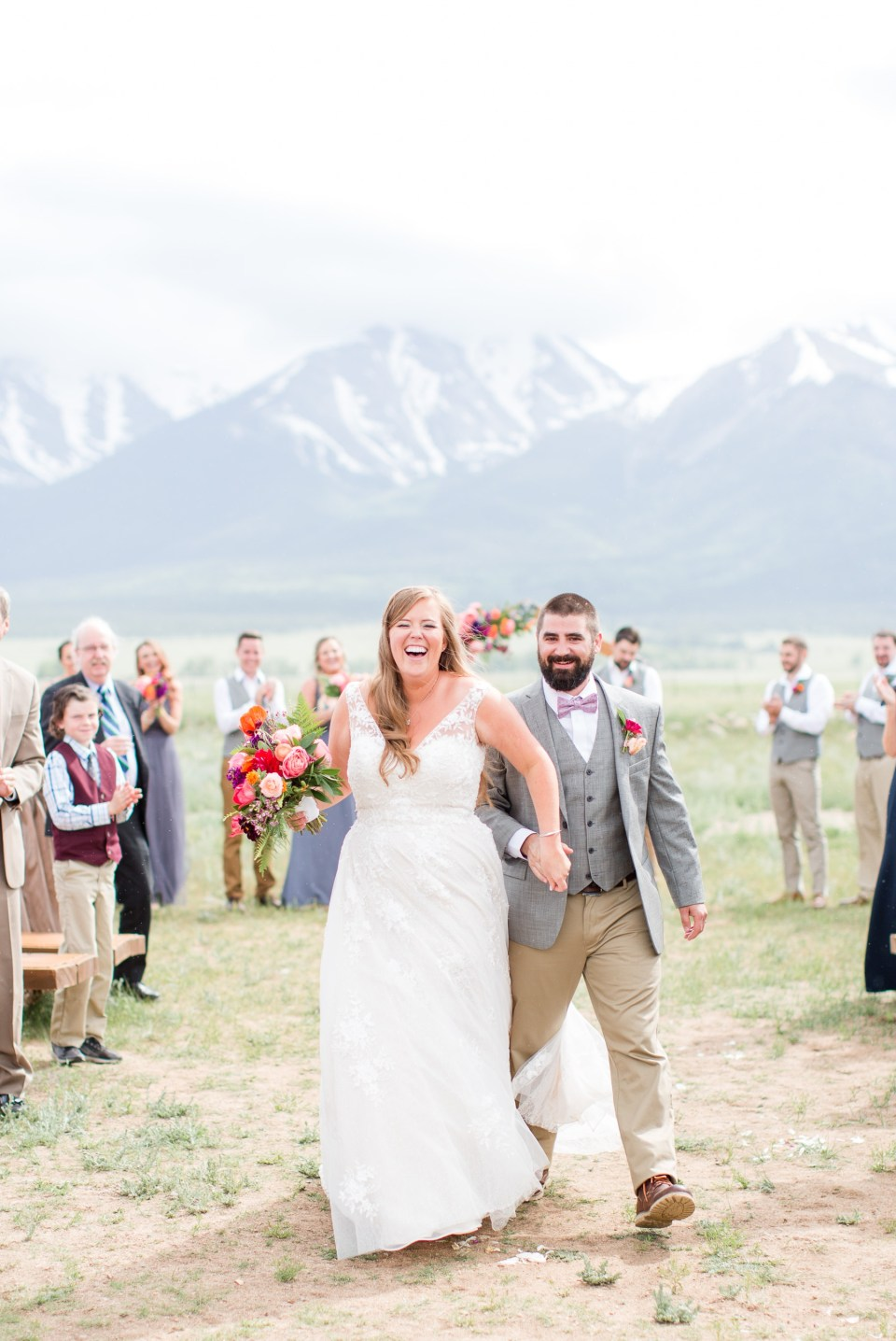Bride and groom being married at the base of a mountain in Colorado during the spring.