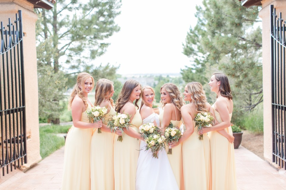 Bride and bridesmaids in yellow davids bridal dresses at the Villa Parker in Parker Colorado.