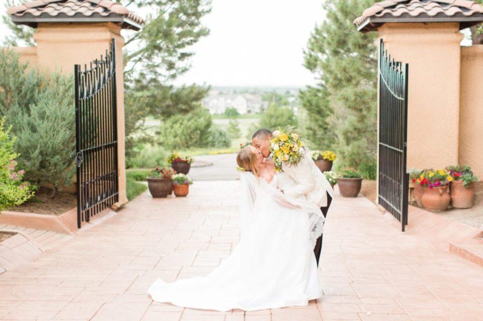 Bride and groom kissing at Parker Colorado wedding venue Villa Parker. Colorado Wedding Photographer, Theresa Bridget Photography
