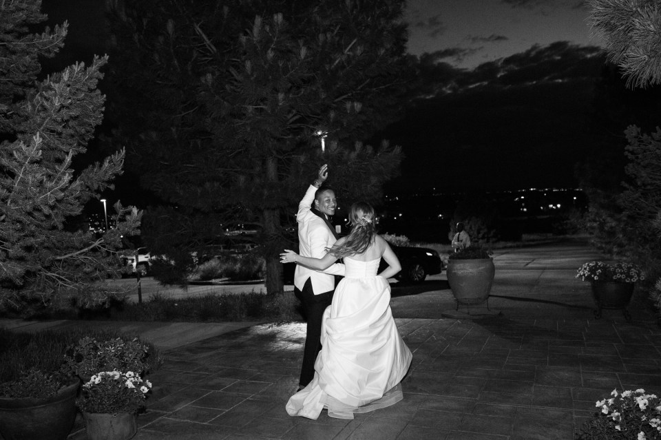 Bride and groom exiting their reception with sparklers at Villa Parker.