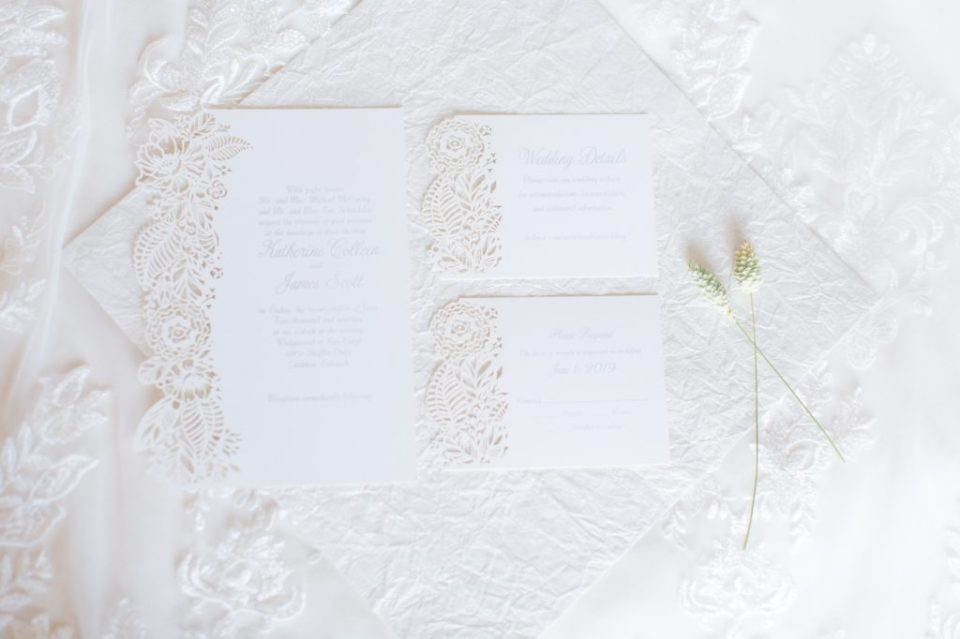 Overhead shot of a wedding invitation suite.