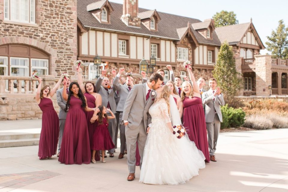 Wedding party posing outside of Highlands Ranch Mansion in Colorado.