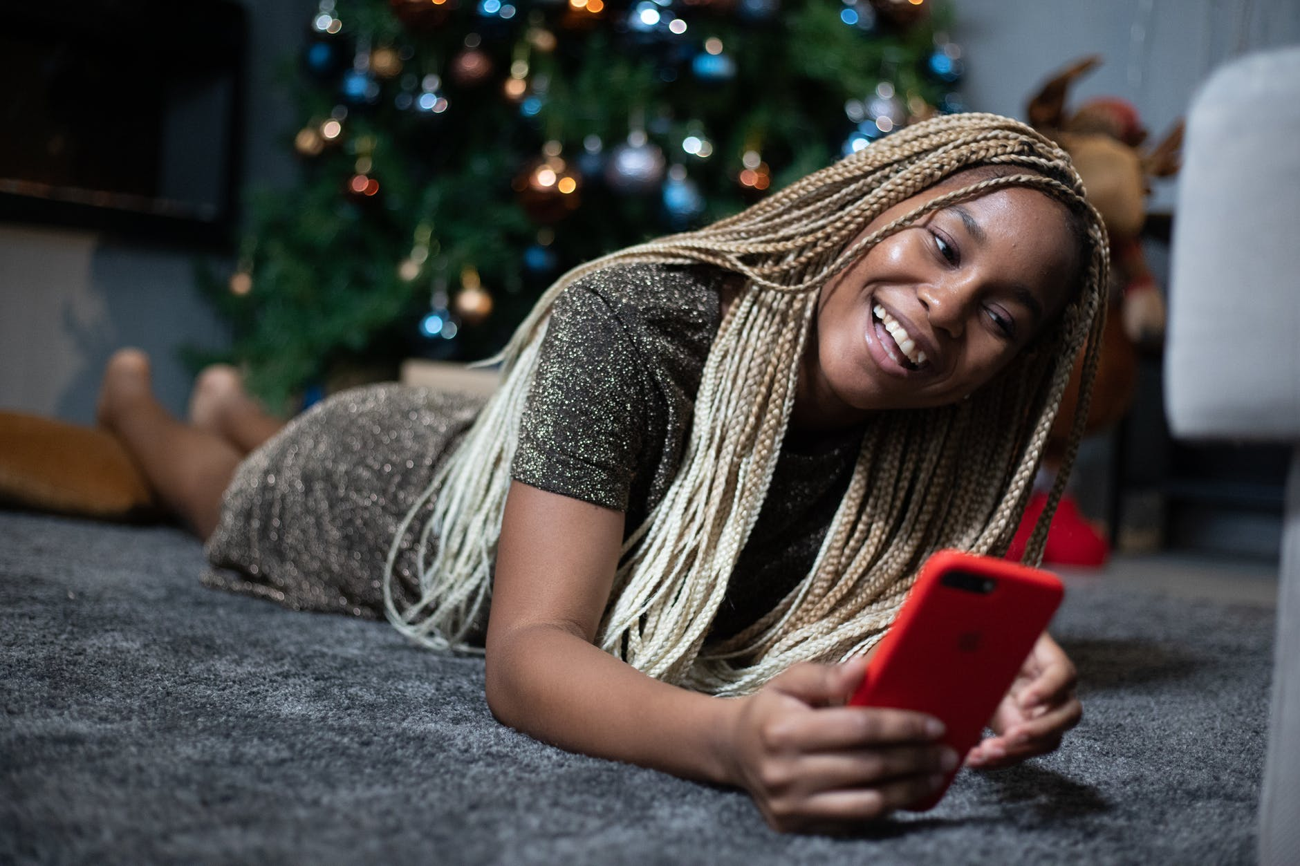 woman holding red smartphone