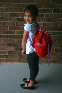 Photo of a girl wearing the backpack.