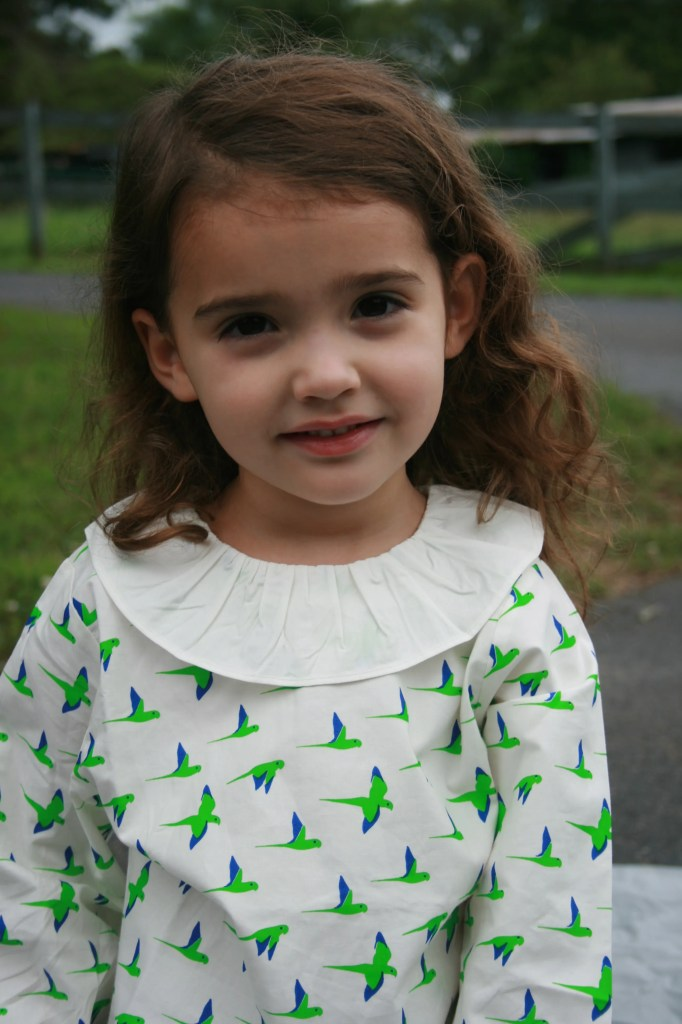 Photo of a girl in Waddler kids' clothing.