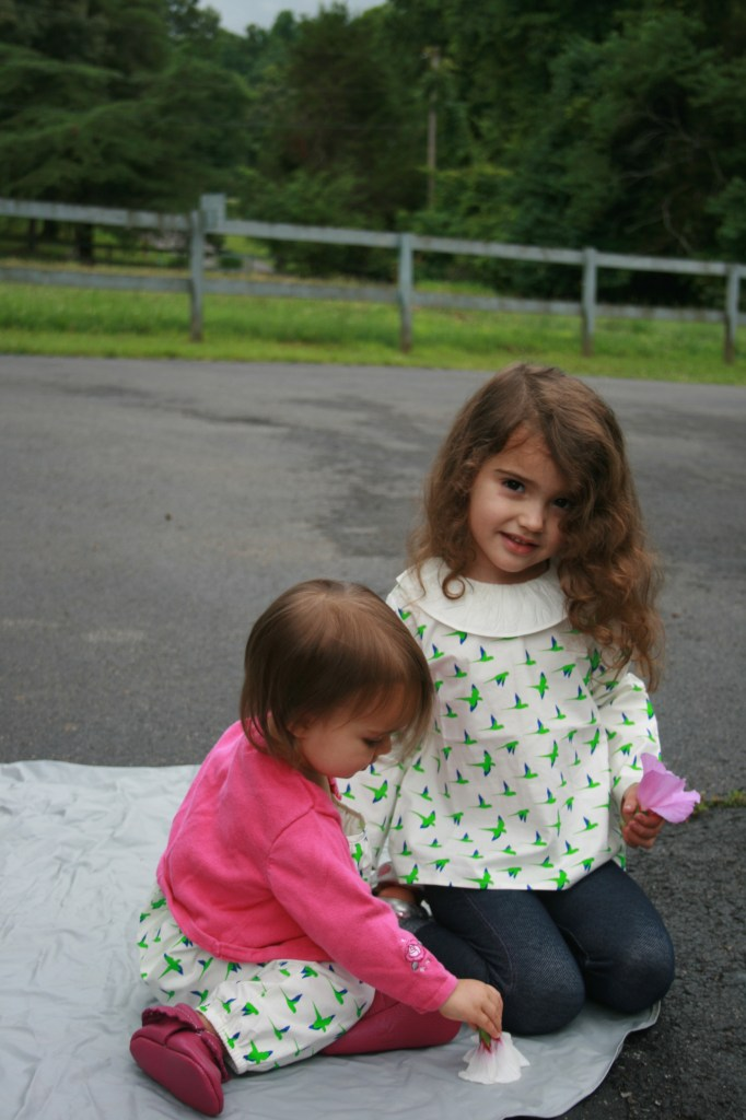 Photo of two girls in Waddler kids' clothing.