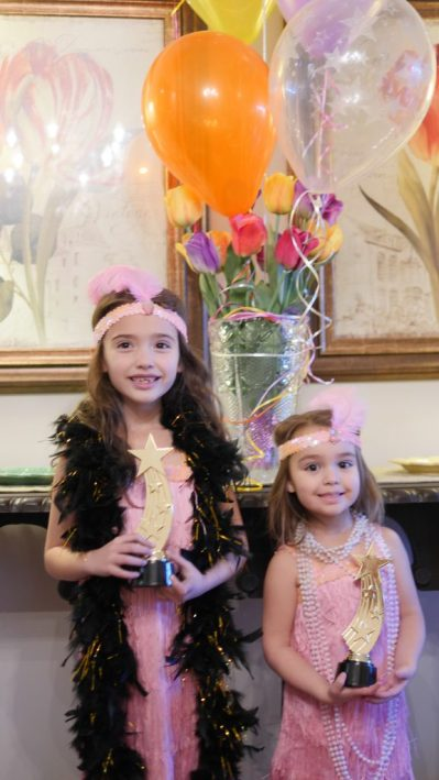 Give out Oscar themed awards to all children who attend. With both of our children wearing the same costume, it was simple to have them tie for best costume. 5 Must Try Tips For The Ultimate Kid-Friendly Oscar Party - Movie Themed Party - Movie Party - Hollywood Party