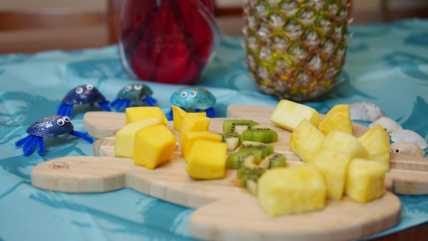 For snacks, buy tropical fruit. We had delicious mangos, kiwi, and pineapple at our Moana party.