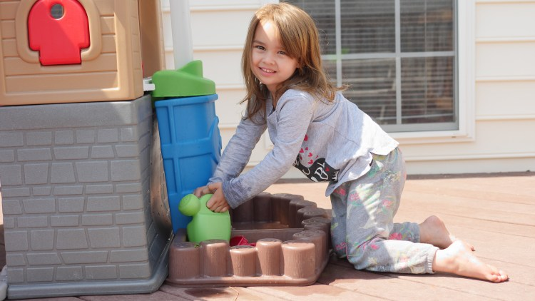 Children can collect water in the rain barrel. Not only is this fun water play for the summer, but it also teaches valuable green living skills! (c) Theresa's Reviews