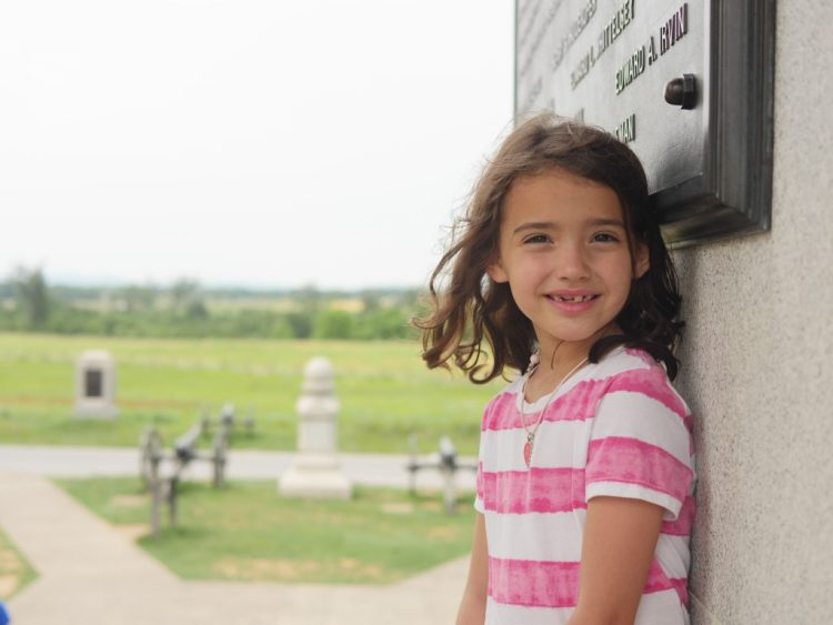 My daughter looking out from the Pennsylvania Monument at the Gettysburg battlefield