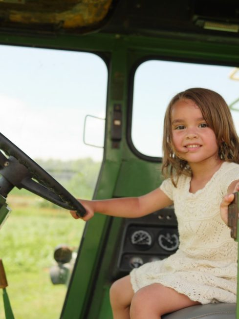 Riding a pretend tractor at Rocky Point Creamery in Frederick County, Maryland