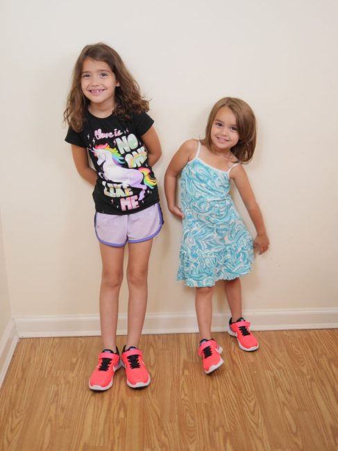 Children enjoying their EasyKicks subscription service with new sneakers.