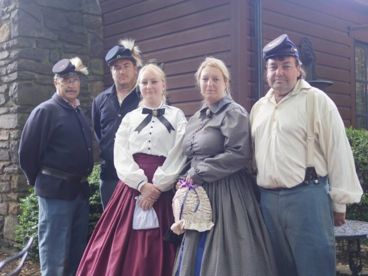 People dressed in Civil War clothes passing through Farnsworth Inn & Tavern in Gettysburg. - Theresa's Reviews
