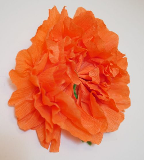 With orange tissue paper and green pipe cleaners, you can create Marigold decorations for your Coco movie party! Theresa's Reviews #CocoBluRay