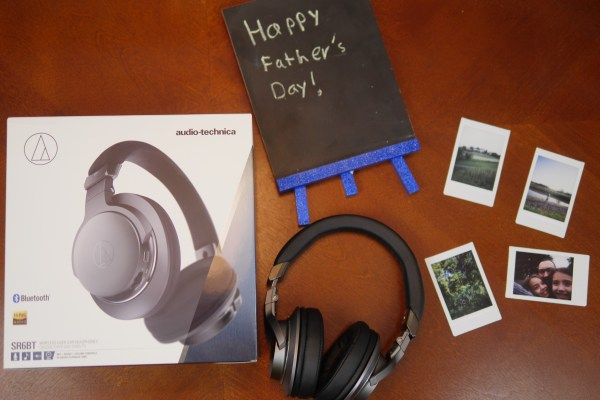 Flat lay photo of Audio Technica headphones with a Happy Father's Day sign and Instax photos. 3 Reasons Musical Gifts Make Dads Happy - Theresa's Reviews