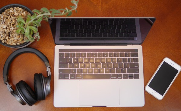 Flat lay photo of Audio Technica headphones with a laptop, cellphone, and succulent. 3 Reasons Musical Gifts Make Dads Happy - Theresa's Reviews