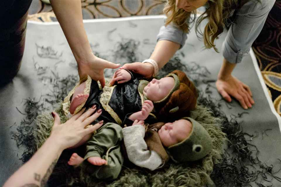Newborn twins are photographed during a styled shoot at the Reset Conference for photographers
