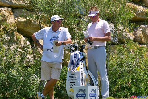 Ian Poulter and caddy