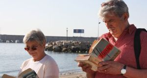 Reading Ulysses on the beach