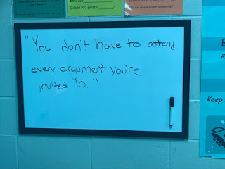 """Drama lunch bunch """"You don't have to attend every argument you're invited to."""" written on board for discussion."""