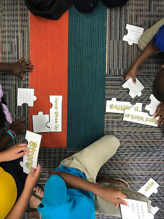 Students involved in Reputation lesson plan puzzle activity