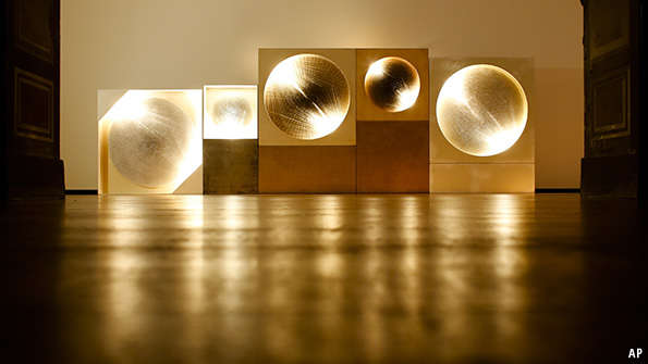 This photograph shows a detail, three of five 'Light Disks', of the art piece 'Cosmic Visions / Light Disks' by German artist Guenther Uecker - MARKUS SCHREIBER — AP Photo