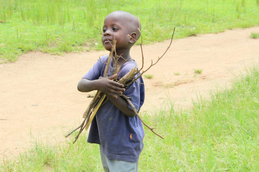 Child with sticks