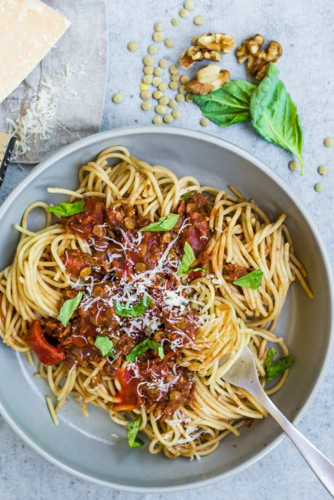 Spaghetti topped with a lentil and walnut red bolognese sauce