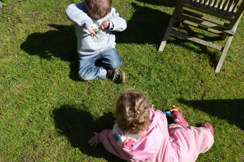 Kids playing in the garden on holiday