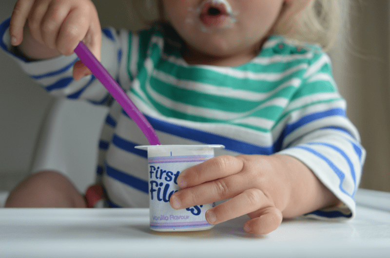 Toddler eating yoghurt