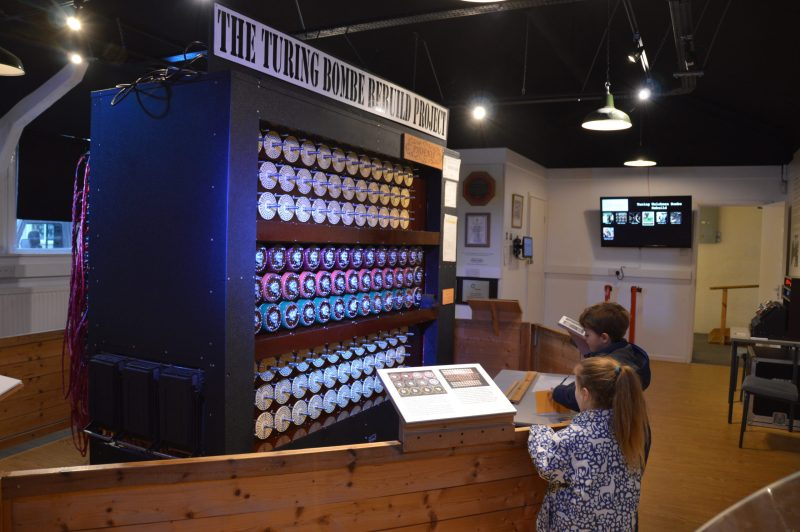 Two children looking at the Turing-Welchman Bombe at the National Museum of Computing