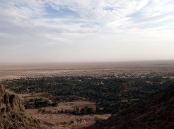 View over the beautifull oasisvillage of Garmeh from a surrounding hill
