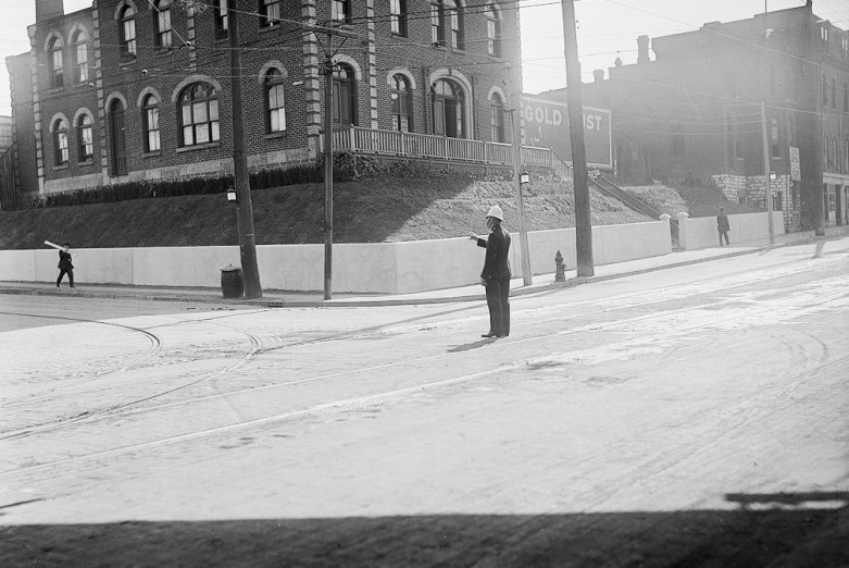Friday Afternoon Gridlock. Policeman directing traffic and people. Queen and Dufferin, view of south west corner. 1917.