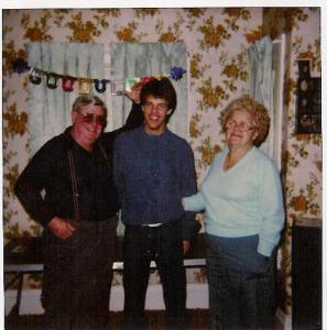 My grandparents and me at my going away party before leaving for the Navy. My grandfather was saying that this is the last time we'll see my hair that high. He was right