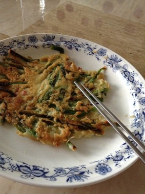 Pajeon, green onion pancake. Best served with unfiltered Korean rice wine, makgeolli!