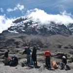 Snacks for Kilimanjaro: snack break with Kili in the background