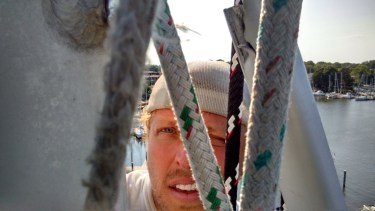 JIMMIE COCKERILL PEERING THOUGH THE ROPES FROM ALOFT